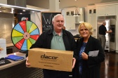 This lucky couple spin the prize wheel and went home with a 7 piece Gourmet Cookware set.